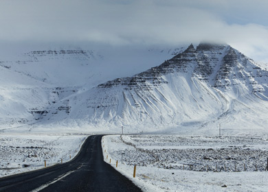 long road in snowy mountains